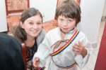 """Copii botezați de Mitropolitul Clujului, la șapte ani de activitate a cantinei sociale """"Protopop Aurel Munteanu"""" din Huedin"""